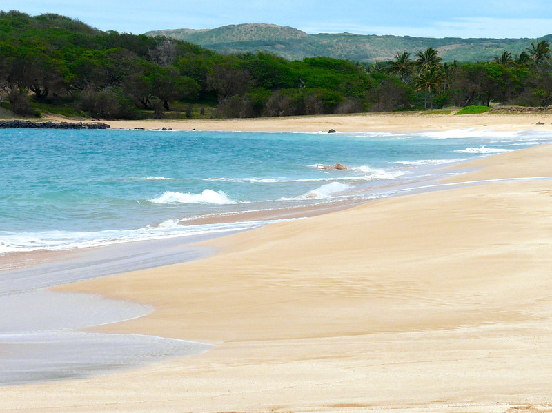 The sands are golden colored and empty of tourists at Papohaku Beach on Moloka'i