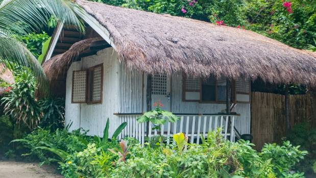 My thatched cottage on Miniloc Island is authentically Filipino.