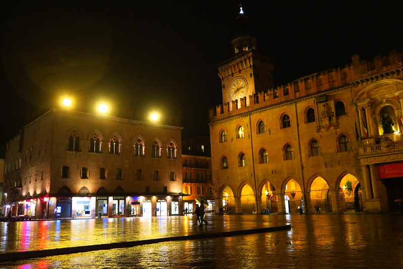 Downtown Bologna, Italy at night with the lights shining brightly
