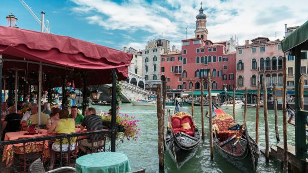 Lunch at a street cafe on the canal in Venice is likely to cost less than dinner, even when it's the same dish.