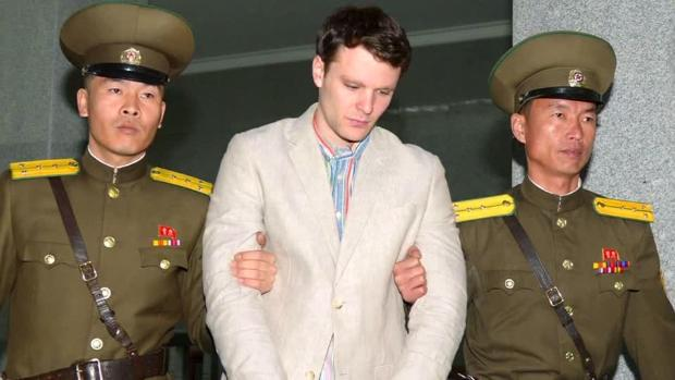 Otto Warmbier was arrested for stealing a propaganda poster.