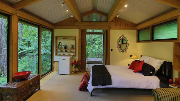Inside a chalet in Auckland, surrounded by over 3000sqm of native bush.