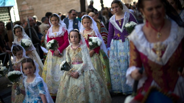 Falleras dress up in traditional costume as part of the annual Las Fallas festival.